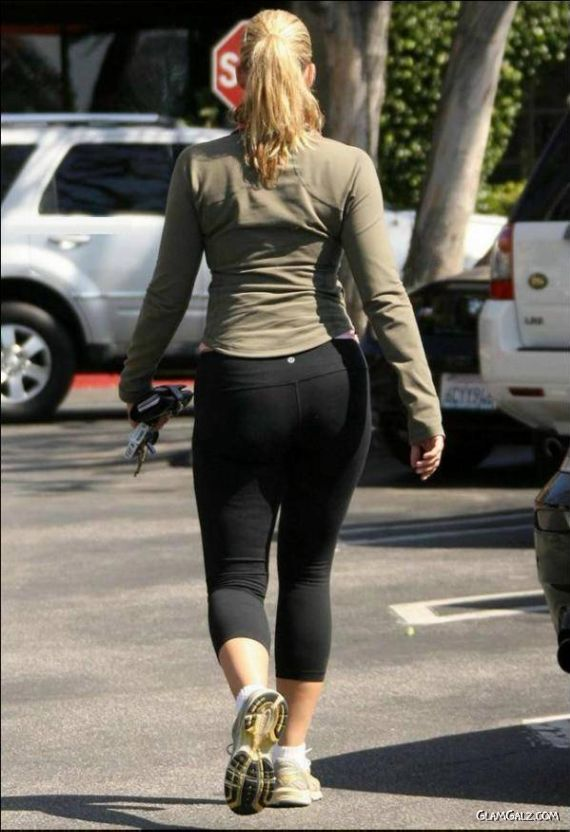 Natasha Henstridge Walking with Coffee
